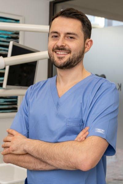 Dr. Alexandru Rau